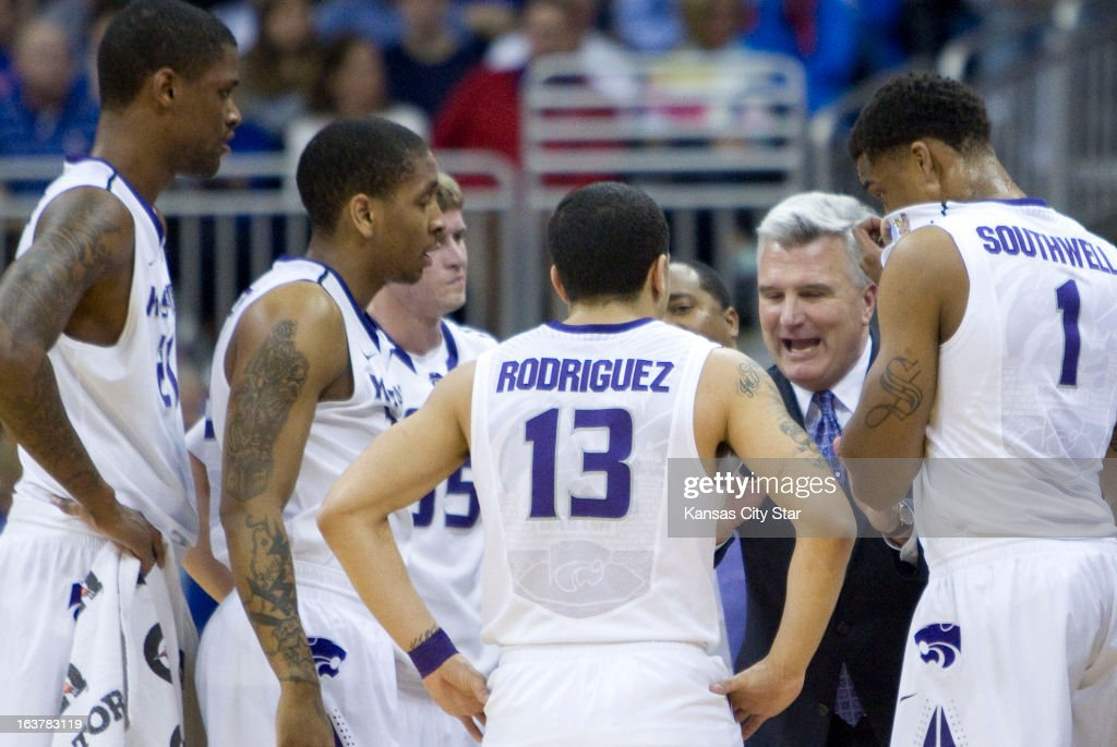 Kansas State head coach Bruce Weber talks to his team during a time out in the first half against Oklahoma State in the Big 12 Tournament semifinals at the Sprint Center in Kansas City, Missouri, on Friday, March 15, 2013