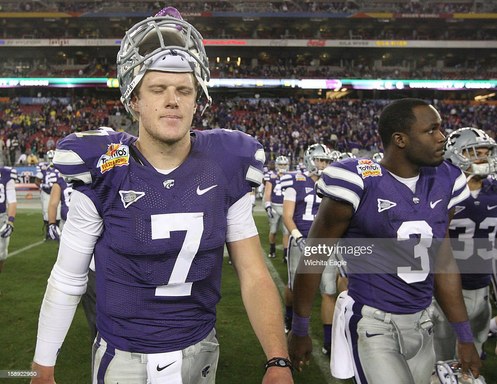 Kansas State quarterback Collin Klein (7) fights his emotions as he leaves the field with fellow senior Chris Harper (3) after a 35-17 loss to Oregon in the Tostitos Fiesta Bowl at the University of Phoenix Stadium in Glendale, Arizona, on Thursday, January 3, 2013.