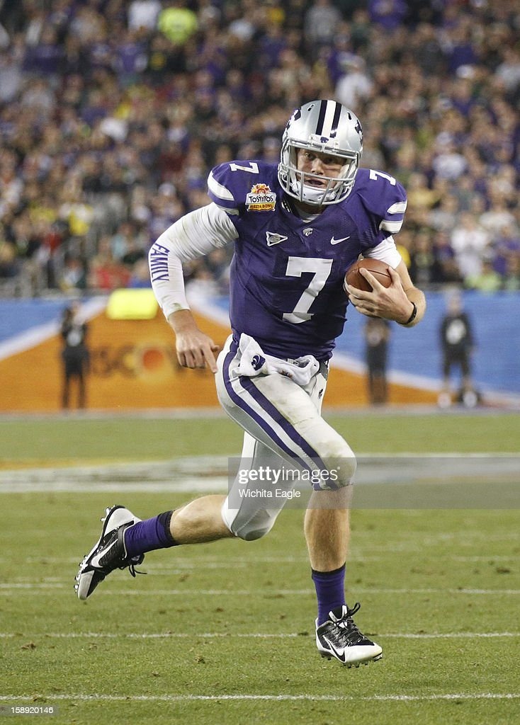Kansas State quarterback Collin Klein (7) makes a long run in the second quarter against Oregon in the Tostitos Fiesta Bowl at the University of Phoenix Stadium in Glendale, Arizona, on Thursday, January 3, 2013.