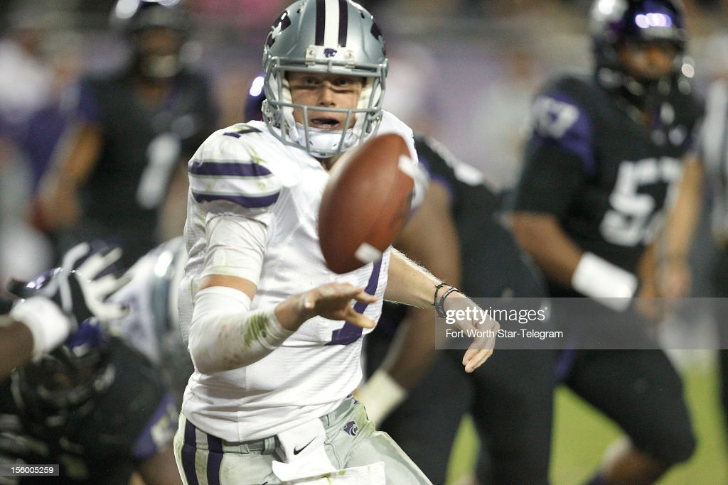 Kansas State quarterback Collin Klein (7) pitches the ball to a running back in the fourth quarter against Texas Christian at Amon G. Carter Stadium in Fort Worth, Texas, on Saturday, November 10, 2012.