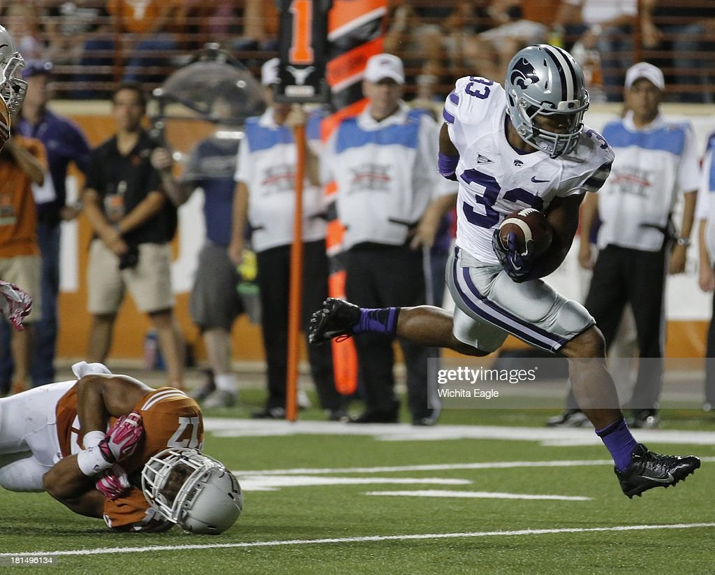 Kansas State running back John Hubert (33) breaks free from Texas safety Adrian Phillips as he runs 15 yards for a touchdown in the second quarter at Royal-Texas Memorial Stadium in Austin, Texas, on Saturday, September 21, 2013.