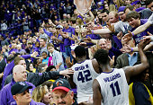 Kansas State seniors Thomas Gipson and Nino Williams celebrate with fans following a 7069 win against Iowa State at Bramlage Coliseum in Manhattan...