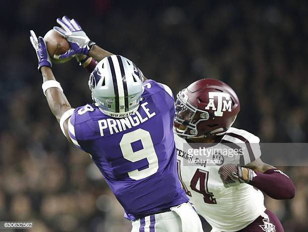 Kansas State wide receiver Byron Pringle can't hang onto a Jesse Ertz pass as it is knocked away by Texas AM defensive back Justin Evans in the Texas...
