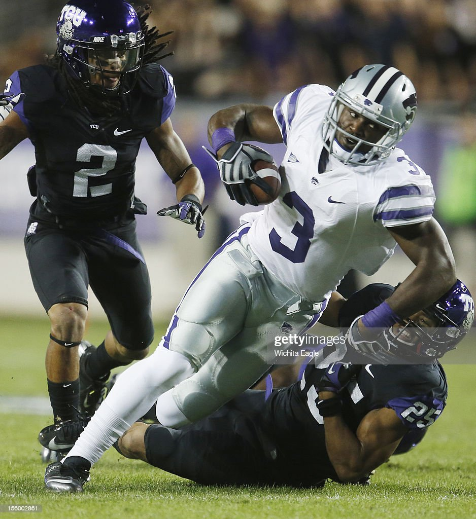 Kansas State wide receiver Chris Harper (3) tries to break free from several Texas Christian defenders after hauling in a Collin Klein pass at Amon G. Carter Stadium in Fort Worth, Texas, on Saturday, November 10, 2012.