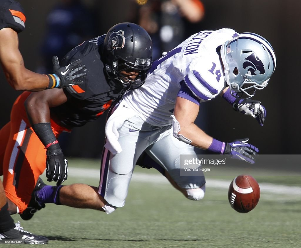 Kansas State wide receiver Curry Sexton (14) drops the ball after making a reception against Oklahoma State in the second half at Boone Pickens Stadium in Stillwater, Oklahoma, Saturday, October 5, 2013. OSU defeated Kansas State, 33-29.