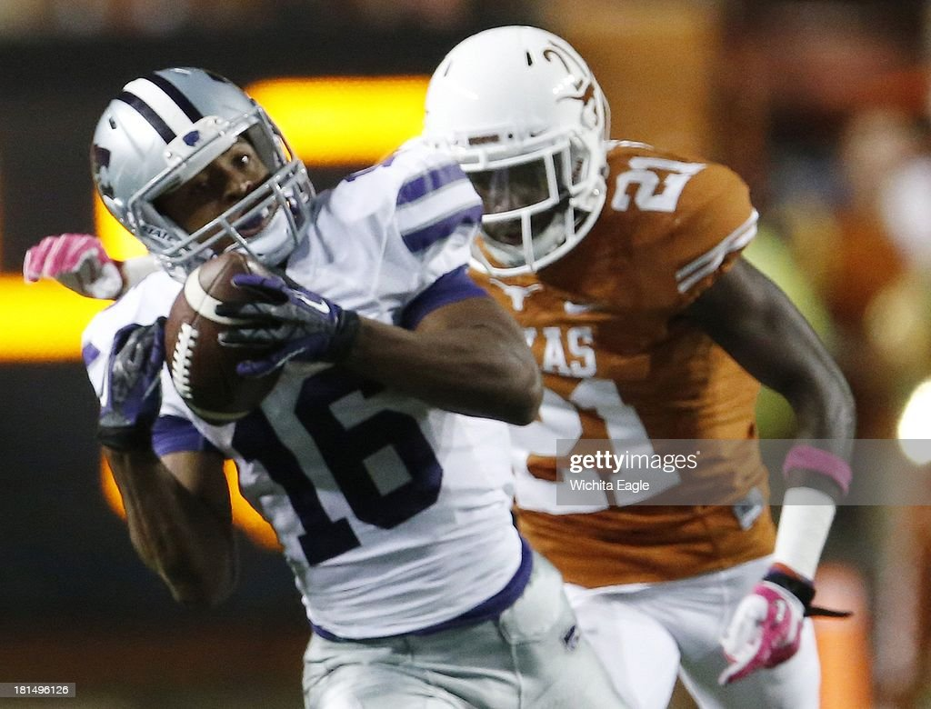 Kansas State wide receiver Tyler Lockett (16) pulls in a long pass ahead of Texas cornerback Duke Thomas in the second quarter at Royal-Texas Memorial Stadium in Austin, Texas, on Saturday, September 21, 2013.