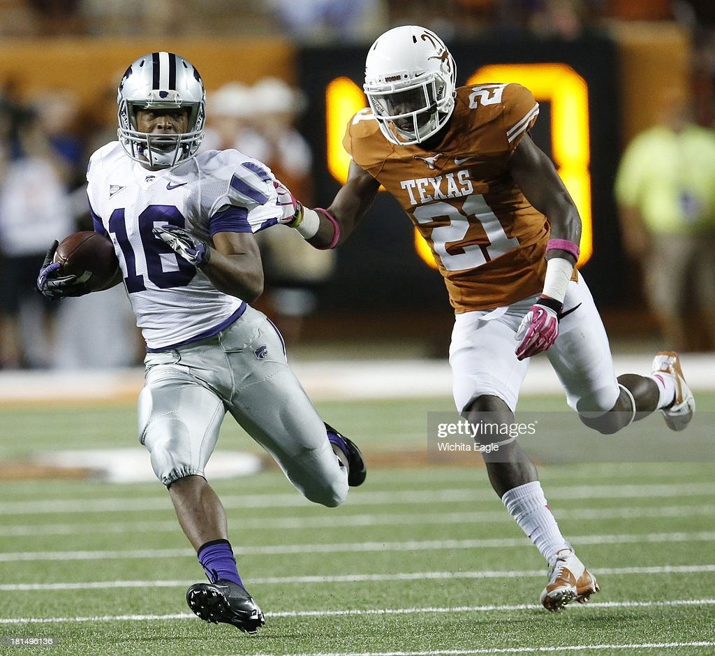 Kansas State wide receiver Tyler Lockett (16) pulls in a long pass ahead of Texas cornerback Duke Thomas in the second quarter at Royal-Texas Memorial Stadium in Austin, Texas, on Saturday, September 21, 2013.