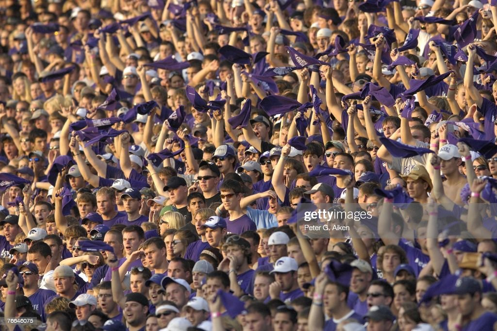 Kansas State Wildcat fans cheer during a NCAA football game against the San Jose State Spartans on September 8 2007 at Bill Snyder Family Stadium in...