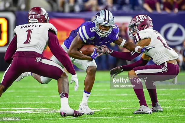 Kansas State Wildcat wide receiver Byron Pringle attempts to split two defenders Texas AM Aggies defensive back Nick Harvey and Texas AM Aggies...