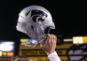 Kansas State Wildcats helmet is lifted following the Buffalo Wild Wings Bowl against the Michigan Wolverines at Sun Devil Stadium on December 28 2013...