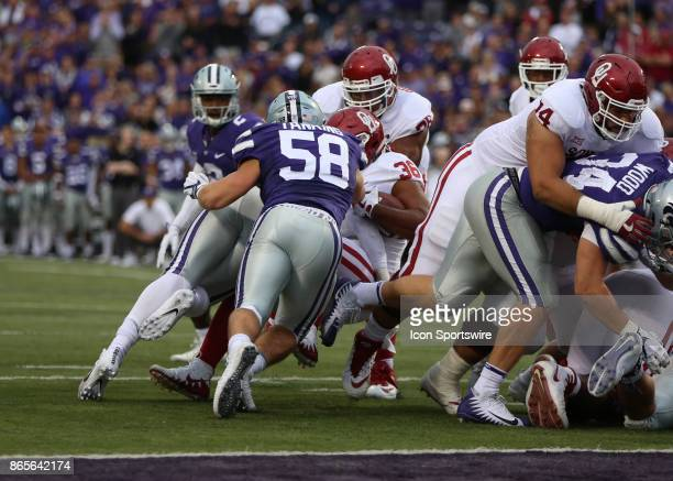 Kansas State Wildcats linebacker Trent Tanking puts a big hit on Oklahoma Sooners fullback Dimitri Flowers to stop him short of the goal line in the...
