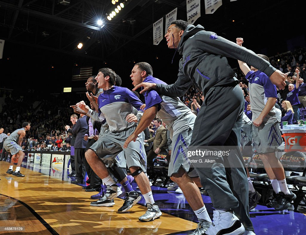 Kansas State Wildcats players storm off the bench after beating the Mississippi Rebels on December 5, 2013 at Bramlage Coliseum in Manhattan, Kansas. Kansas State won 61-58.