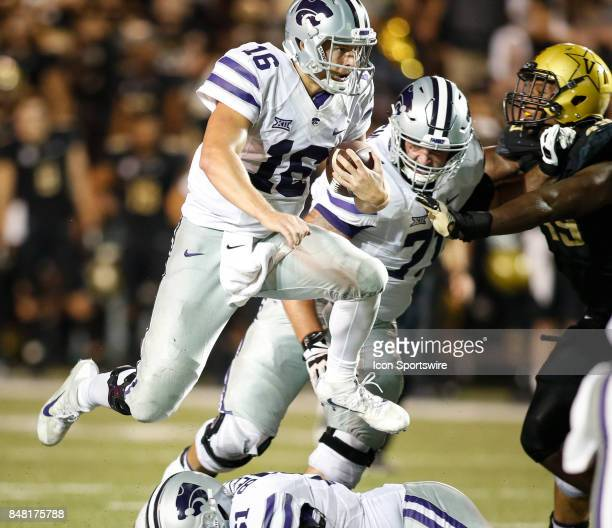 Kansas State Wildcats QB Jesse Ertz hurdles a lineman during a college football game between the Vanderbilt Commodores and the Kansas State Wildcats...