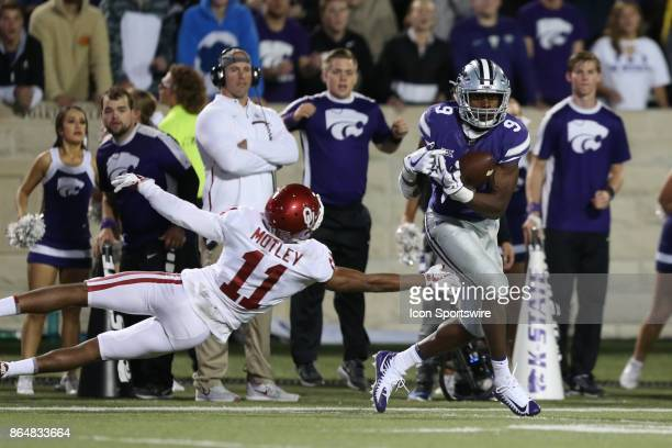 Kansas State Wildcats wide receiver Byron Pringle hauls in a 40yard reception in front of Oklahoma Sooners cornerback Parnell Motley late in the...