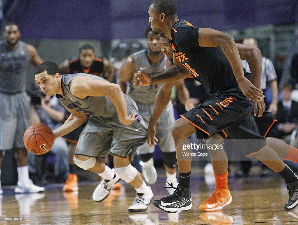 Kansas State's Angel Rodriguez, left, heads upcourt after picking up a loose ball against Oklahoma State in the second half at Bramlage Coliseum in Manhattan, Kansas, Saturday, January 5, 2013. Kansas State beat Oklahoma State, 73-67.