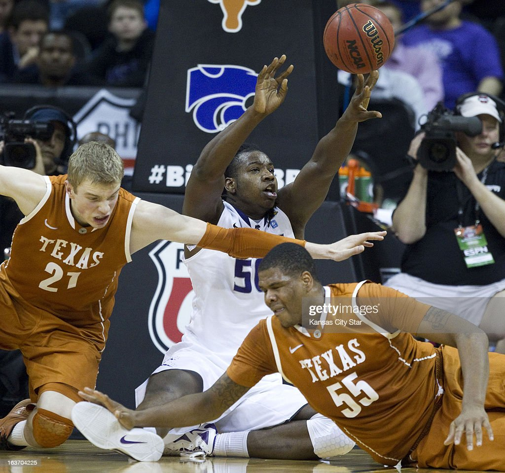 Kansas State's D.J. Johnson (50) passes a loose ball off, leaving Texas' Connor Lammert (21) and Cameron Ridley (55) scrambling, in the second half in the quarterfinals of the Big 12 Tournament at the Sprint Center in Kansas City, Missouri, on Thursday, March 14, 2013. Kansas State won, 66-49.