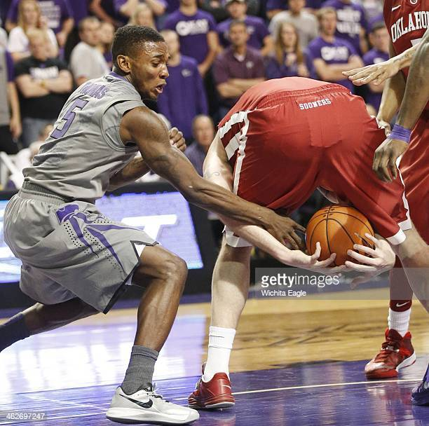 Kansas State's Jevon Thomas left tries to the grab the ball from Oklahoma's Ryan Splangler at Bramlage Coliseum in Manhattan Kan on Tuesday Jan 14...