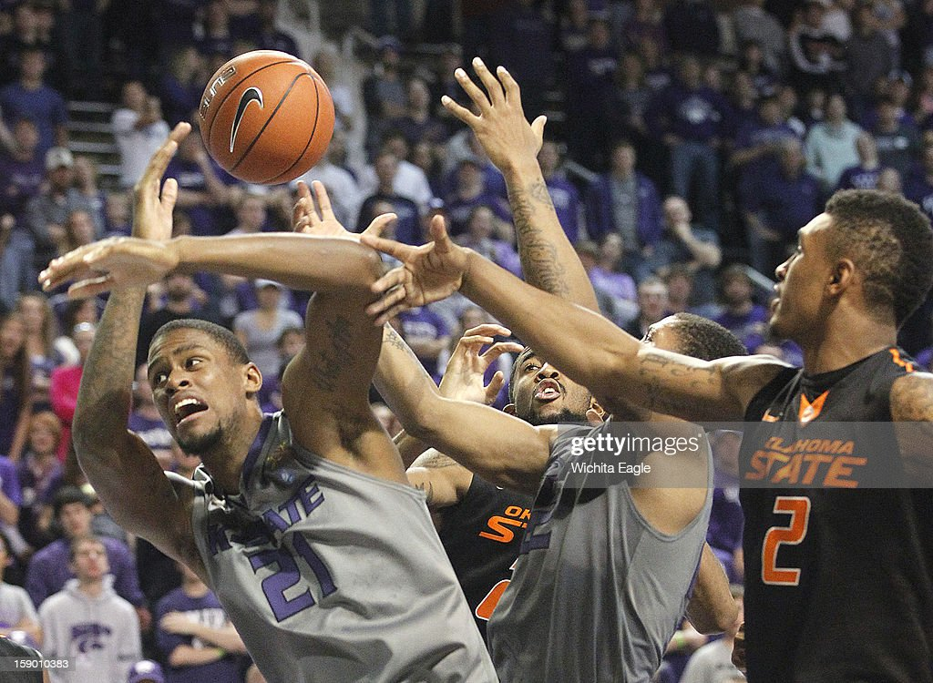 Kansas State's Jordan Henriquez (21) battles for a rebound against Oklahoma State's Le'Bryan Nash in the second half at Bramlage Coliseum in Manhattan, Kansas, Saturday, January 5, 2013. Kansas State beat Oklahoma State, 73-67.