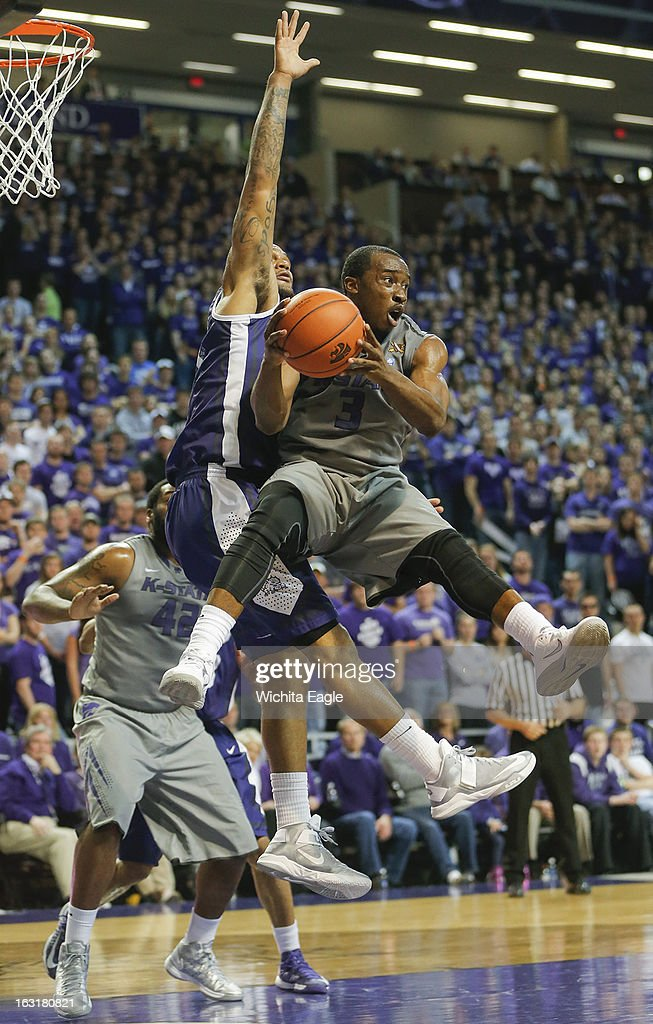 Kansas State's Martavious Irving looks for a pass against Texas Christian's Adrick McKinney during the second half at Bramlage Coliseum in Manhattan, Kansas, on Tuesday, March 5, 2013. K-State topped TCU, 79-68.