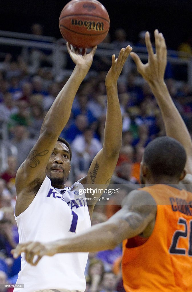 Kansas State's Shane Southwell (1) shoots over Oklahoma State's Kamari Murphy (21) in the first half of the Big 12 Tournament semifinals at the Sprint Center in Kansas City, Missouri, on Friday, March 15, 2013