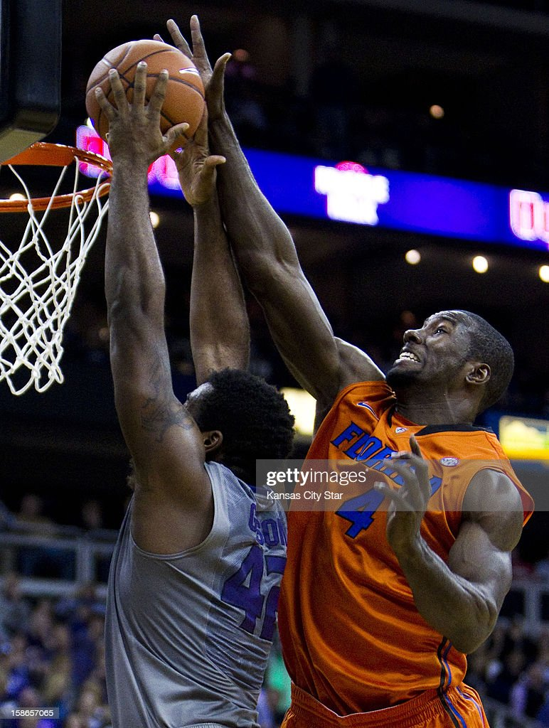 Kansas State's Thomas Gipson (42) has his shot altered by Florida's Patric Young (4) in the first half at Spring Arena in Kansas City, Missouri, on Saturday, December 22, 2012.