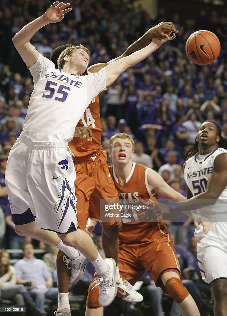 Kansas State's Will Spradling (55) battles for a rebound against Texas' Julien Lewis during the second half at Bramlage Coliseum in Manhattan, Kansas, on Wednesday, January 30, 2013. K-State won, 83-57.