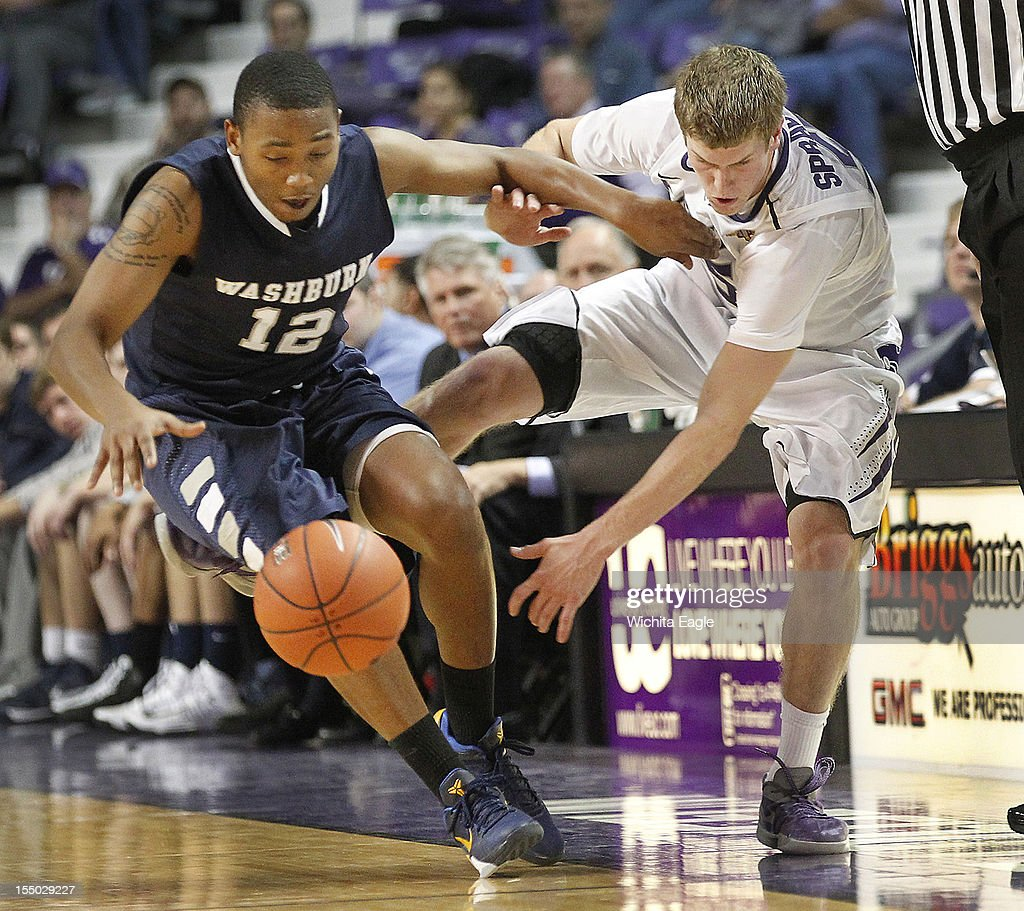 Kansas State's Will Spradling, right, and Washburn's Martin Mitchell (12) battle for a loose ball in the second half at Bramlage Colseum in Manhattan, Kansas, on Tuesday, October 30, 2012.