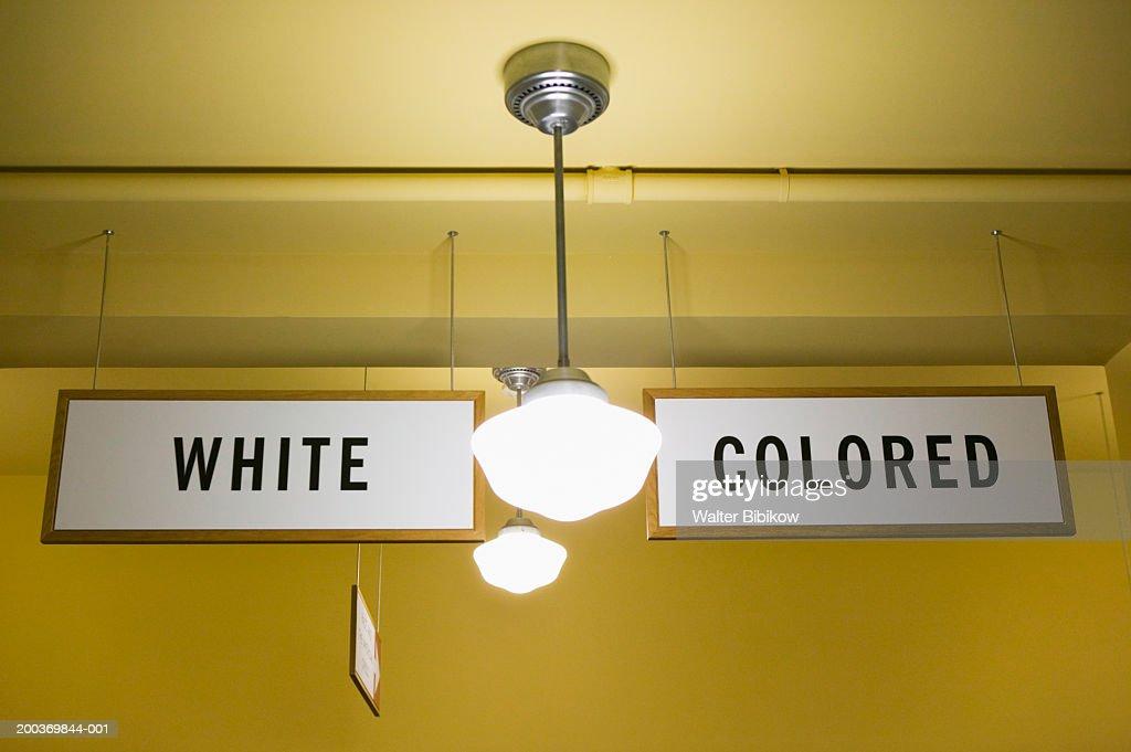 USA, Kansas, Topeka, White and Colored segregation signs : Stock Photo