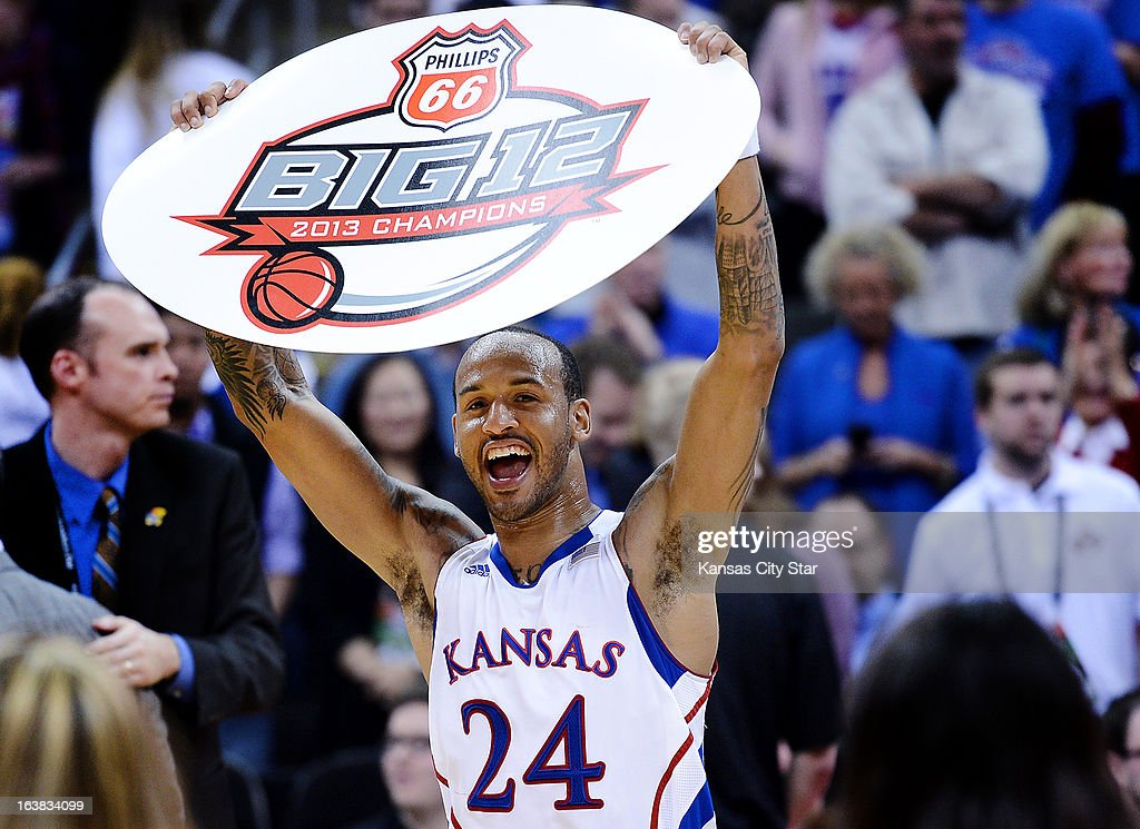 Kansas' Travis Releford celebrates a Big 12 Tournament championship after a 70-54 win against Kansas State at the Sprint Center in Kansas City, Missouri, on Saturday, March 16, 2013.