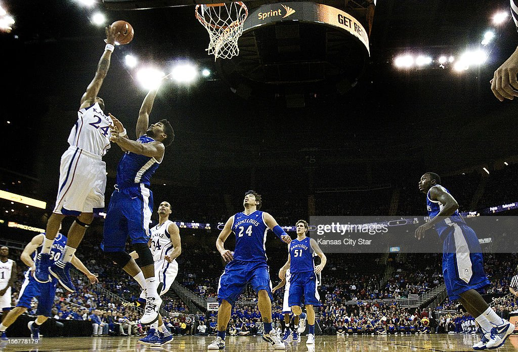 Kansas' Travis Releford takes a shot over Saint Louis' Dwayne Evans during the first half in the championship of the CBE Hall of Fame Classic at the Sprint Center in Kansas City, Missouri, on Tuesday, November 20, 2012. Kansas defeated Saint Louis, 73-59.