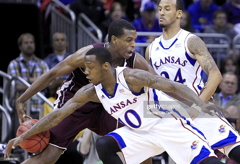 Kansas's Tyshawn Taylor, front, and teammate Travis Releford put the squeeze on Texas A&M's Khris Middleton as he tried to drive to the basket during the second half of the Big 12 Men's Basketball Tournament at the Sprint Center on Thursday, March 8, 2012, in Kansas City, Missouri.