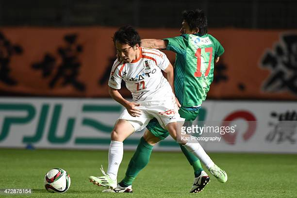 Kanta Kondo of Ehime FC keeps the ball under the pressure from Shun Nogaito of FC Gifu during the JLeague second division match between FC Gifu and...