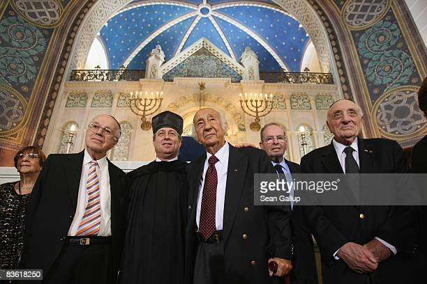 Kantor Isaac Sheffer poses with Kristallnacht eyewitnesses Dov Laor Rolf Joseph Ernst Cramer and Robert Goldmann after a commemorative service for...