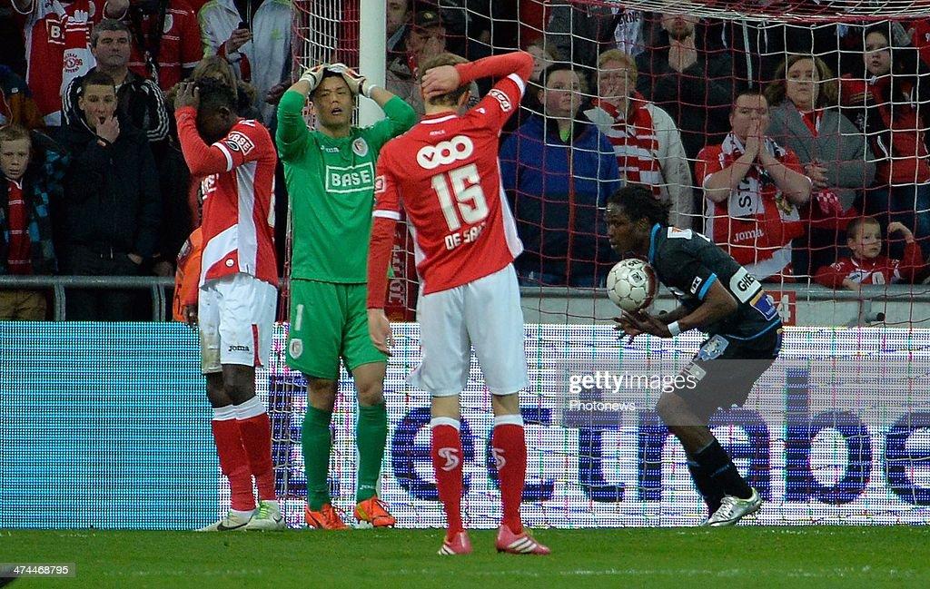 Kanu of Standard Liege and Eiji Kawashima goalkeeper of Standard Liege react during the Jupiler League match between Standard Liege and KAA Gent on...