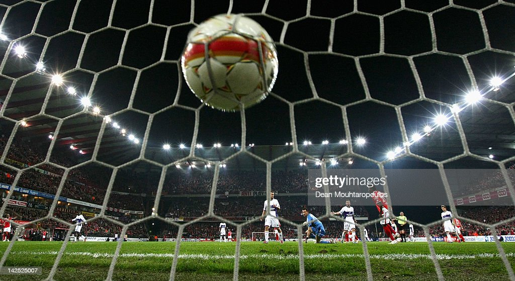 Kanu of Standard scores past goalkeeper Silvio Proto of Anderlecht only for the goal to be ruled off side during the Jupiler League match between...