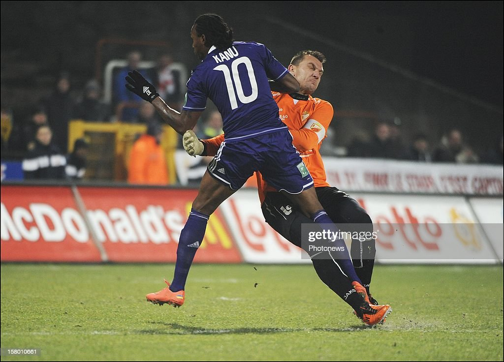 MONS, BELGIUM - DECEMBER 08 Kanu Rubenilson Dos Santos de Rocha of RSC Anderlecht and Cedric Berthelin (RAEC Mons) clash during the Jupiler League match between RAEC MONS vs RSC Anderlecht on December 08 , 2012 in Mons, Belgium.
