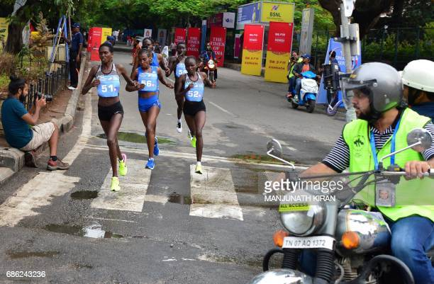 Kanyan runner Irene Cheptai from Kenya takes the lead during the women's TCS World 10K Bengaluru 2017 race in the Indian city of Bangalore on May 21...