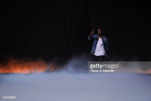 Kanye West acknowledges the applause of the audience after the Kanye West ReadyToWear Fall/Winter 2012 show as part of Paris Fashion Week at Halle...