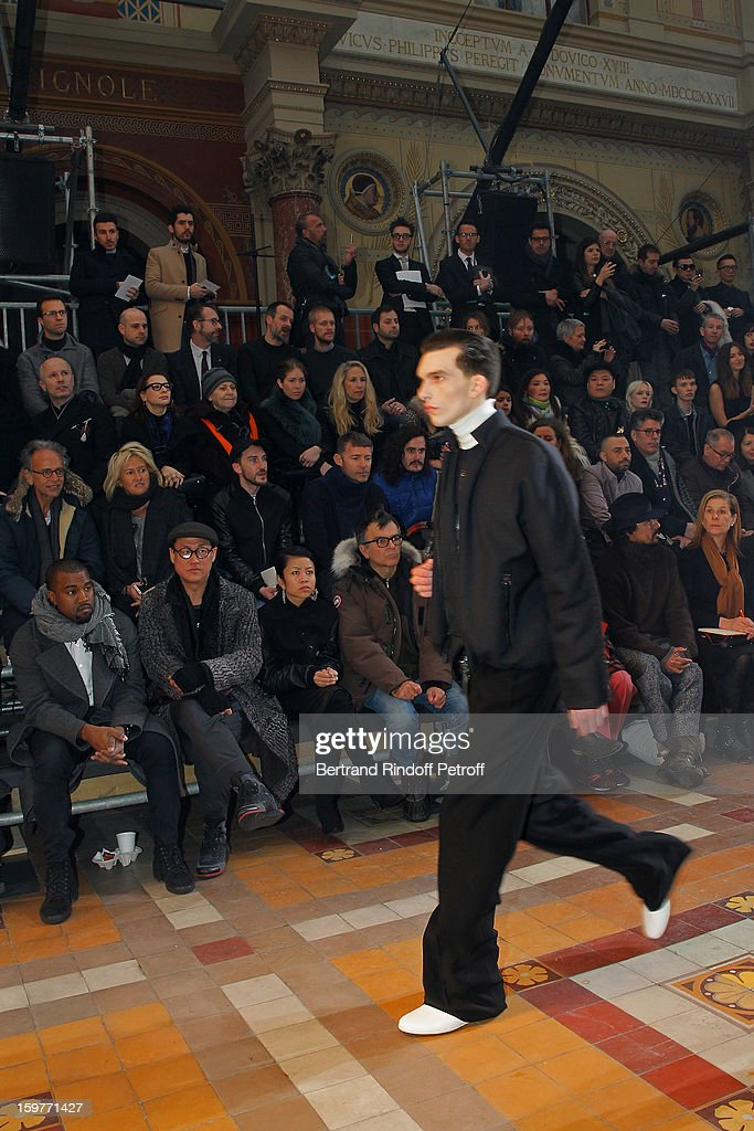 Kanye West, Alex Koo, guest and sculptor Fabrice Hyber attend the Lanvin Men Autumn / Winter 2013 show at Ecole Nationale Superieure Des Beaux-Arts as part of Paris Fashion Week on January 20, 2013 in Paris, France.