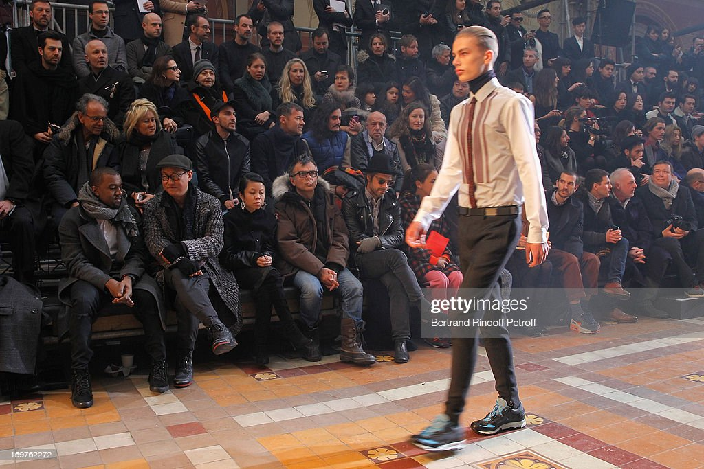 Kanye West, Alex Koo, guest, sculptor Fabrice Hyber, Aaron Young and Laure Heriard Dubreuil attend the Lanvin Men Autumn / Winter 2013 show at Ecole Nationale Superieure Des Beaux-Arts as part of Paris Fashion Week on January 20, 2013 in Paris, France.