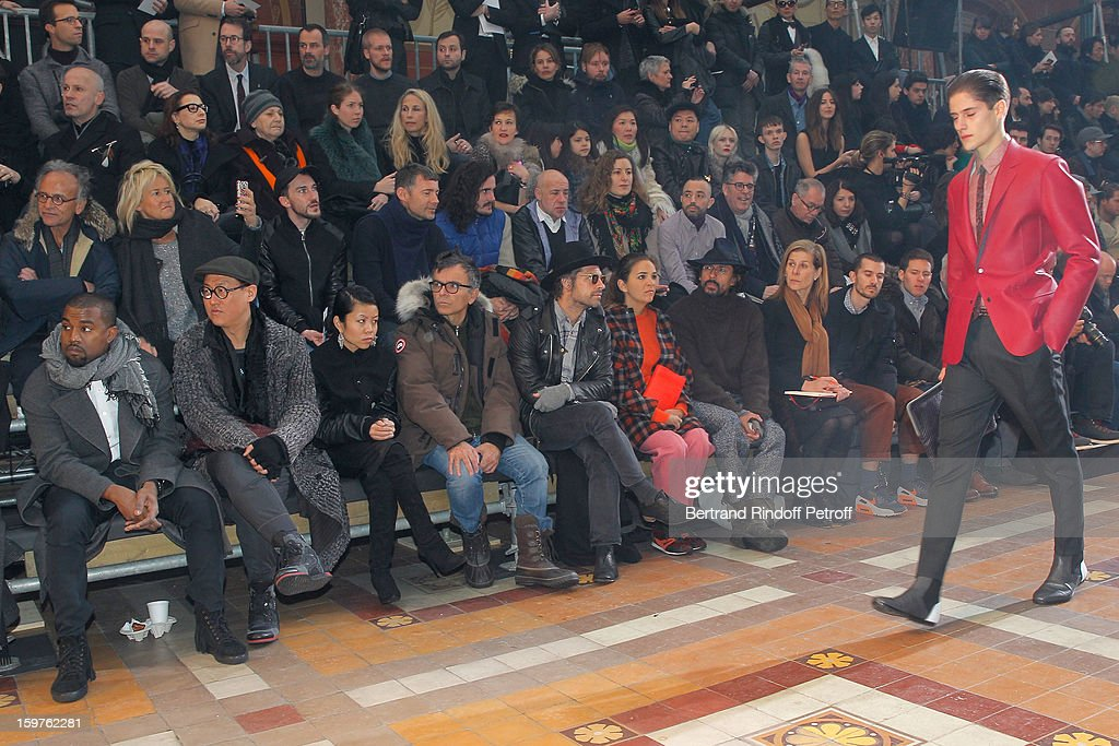 Kanye West, Alex Koo, guest, sculptor Fabrice Hyber, Aaron Young, Laure Heriard Dubreuil and Hayder Ackerman attend the Lanvin Men Autumn / Winter 2013 show at Ecole Nationale Superieure Des Beaux-Arts as part of Paris Fashion Week on January 20, 2013 in Paris, France.