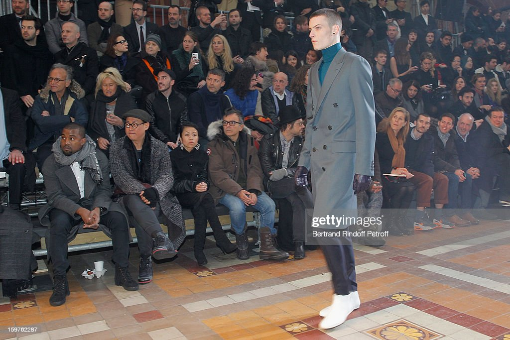 Kanye West, Alex Koo, guest, sculptor Fabrice Hyber and Aaron Young attend the Lanvin Men Autumn / Winter 2013 show at Ecole Nationale Superieure Des Beaux-Arts as part of Paris Fashion Week on January 20, 2013 in Paris, France.