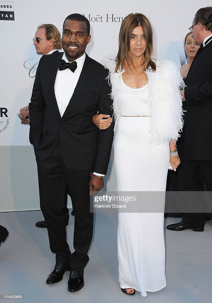 Kanye West and Carine Roitfeld attend amfAR's Cinema Against AIDS Gala during the 64th Annual Cannes Film Festival at Hotel Du Cap on May 19, 2011 in Antibes, France.