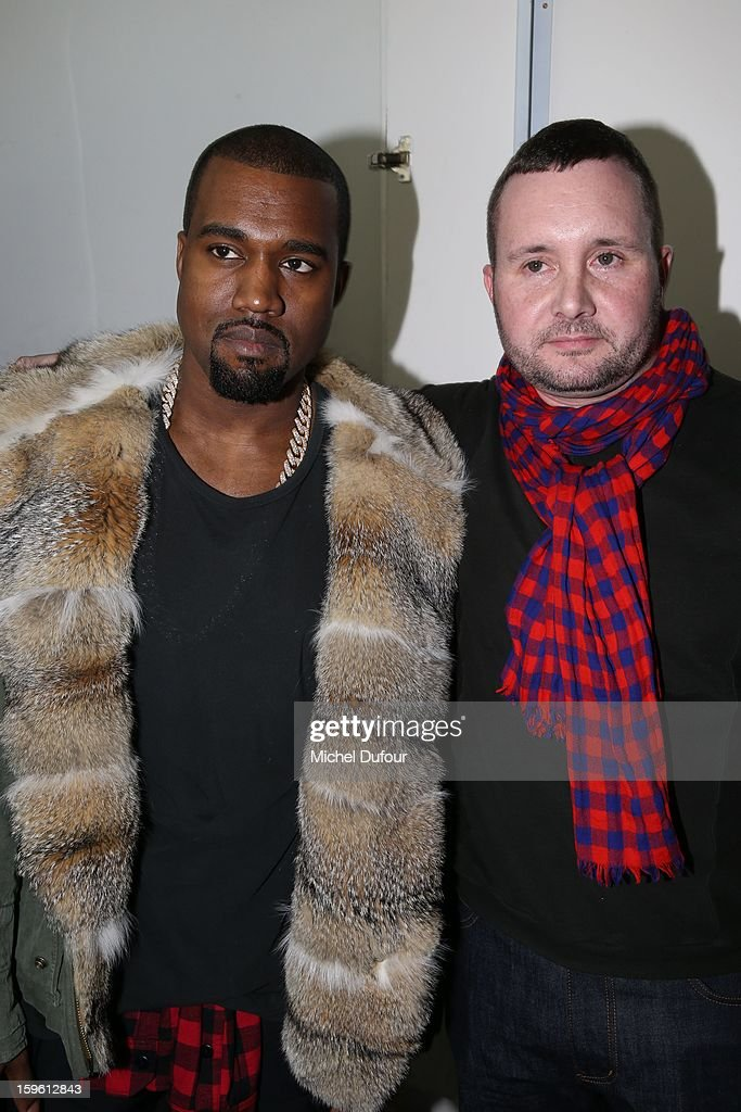 Kanye West and designer Kim Jones attend the Louis Vuitton Men Autumn / Winter 2013 show as part of Paris Fashion Week on January 17, 2013 in Paris, France.