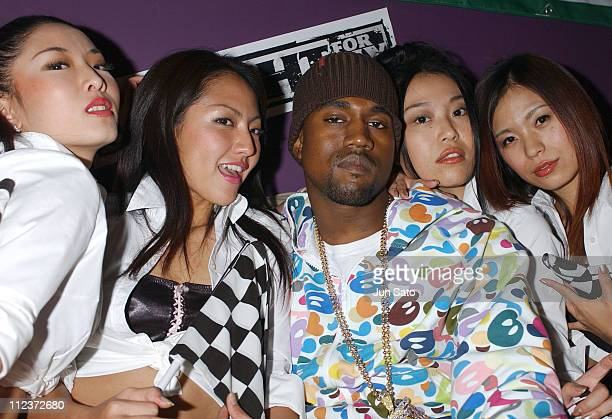 Kanye West and EA Games models during EA Games Hosts 'Def Jam Fight For NY' featured Kanye West Party Backstage at Alife Club in Tokyo Japan