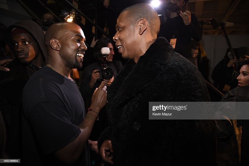 Kanye West (L) and Jay-Z backstage at the adidas Originals x Kanye West YEEZY SEASON 1 fashion show during New York Fashion Week Fall 2015 at Skylight Clarkson Sq on February 12, 2015 in New York City.