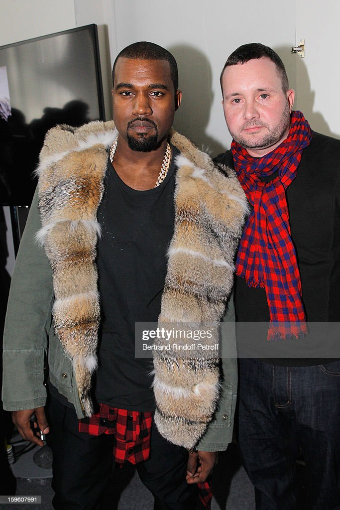 <a gi-track='captionPersonalityLinkClicked' href=/galleries/search?phrase=Kanye+West+-+Musiker&family=editorial&specificpeople=201803 ng-click='$event.stopPropagation()'>Kanye West</a> (L) and Kim Jones attend the Louis Vuitton Men Autumn / Winter 2013 show as part of Paris Fashion Week on January 17, 2013 in Paris, France.