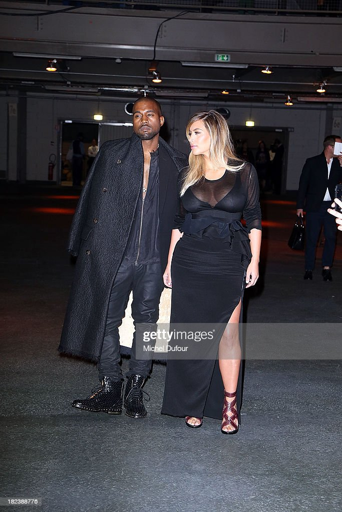 <a gi-track='captionPersonalityLinkClicked' href=/galleries/search?phrase=Kanye+West+-+Musician&family=editorial&specificpeople=201803 ng-click='$event.stopPropagation()'>Kanye West</a> and Kim Kardanshian attend the Givenchy show as part of the Paris Fashion Week Womenswear Spring/Summer 2014 on September 29, 2013 in Paris, France.