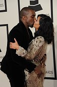 Kanye West and Kim Kardashian arrive on the red carpet for the 57th Annual Grammy Awards in Los Angeles February 8 2015 AFP PHOTO / VALERIE MACON