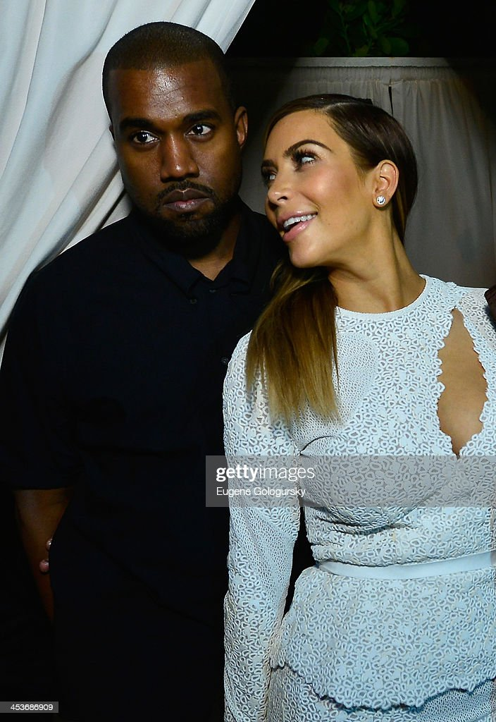 <a gi-track='captionPersonalityLinkClicked' href=/galleries/search?phrase=Kanye+West+-+Musician&family=editorial&specificpeople=201803 ng-click='$event.stopPropagation()'>Kanye West</a> (L) and <a gi-track='captionPersonalityLinkClicked' href=/galleries/search?phrase=Kim+Kardashian&family=editorial&specificpeople=753387 ng-click='$event.stopPropagation()'>Kim Kardashian</a> attend DuJour Magazine's event to honor artist Marc Quinn at Delano South Beach Club on December 4, 2013 in Miami Beach, Florida.